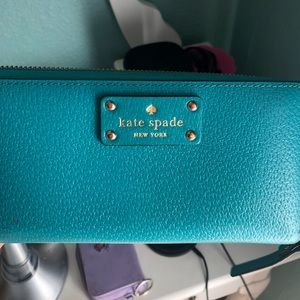 Turquoise Kate spade wallet. Full size